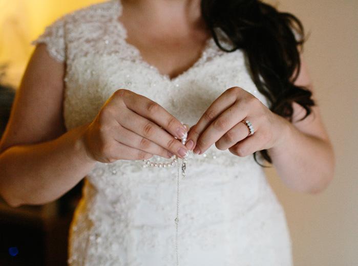 bride unclasping necklace