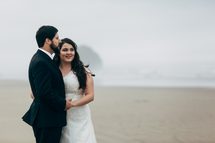 bride and groom portrait on foggy beach