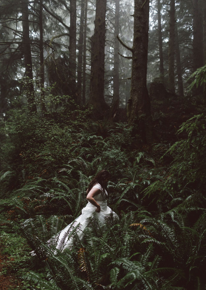 bride hiking through forest