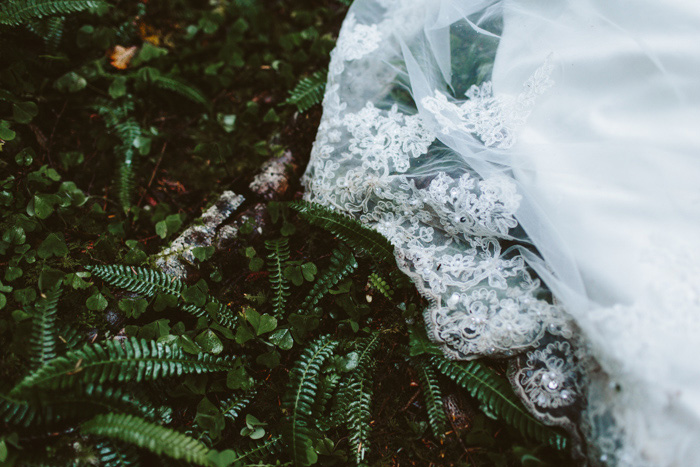 bride's train on forest floor