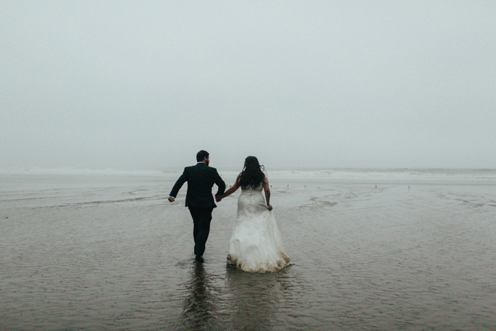 bride and groom on foggy Oregon beach