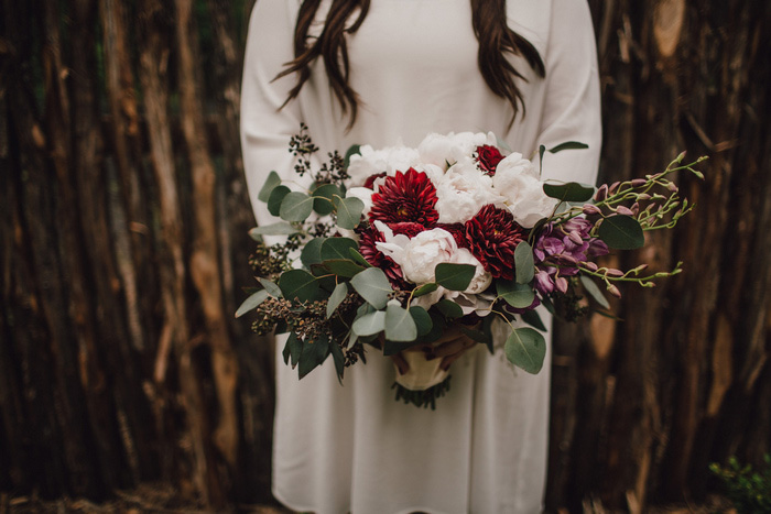 white, red, and green wedding bouquet