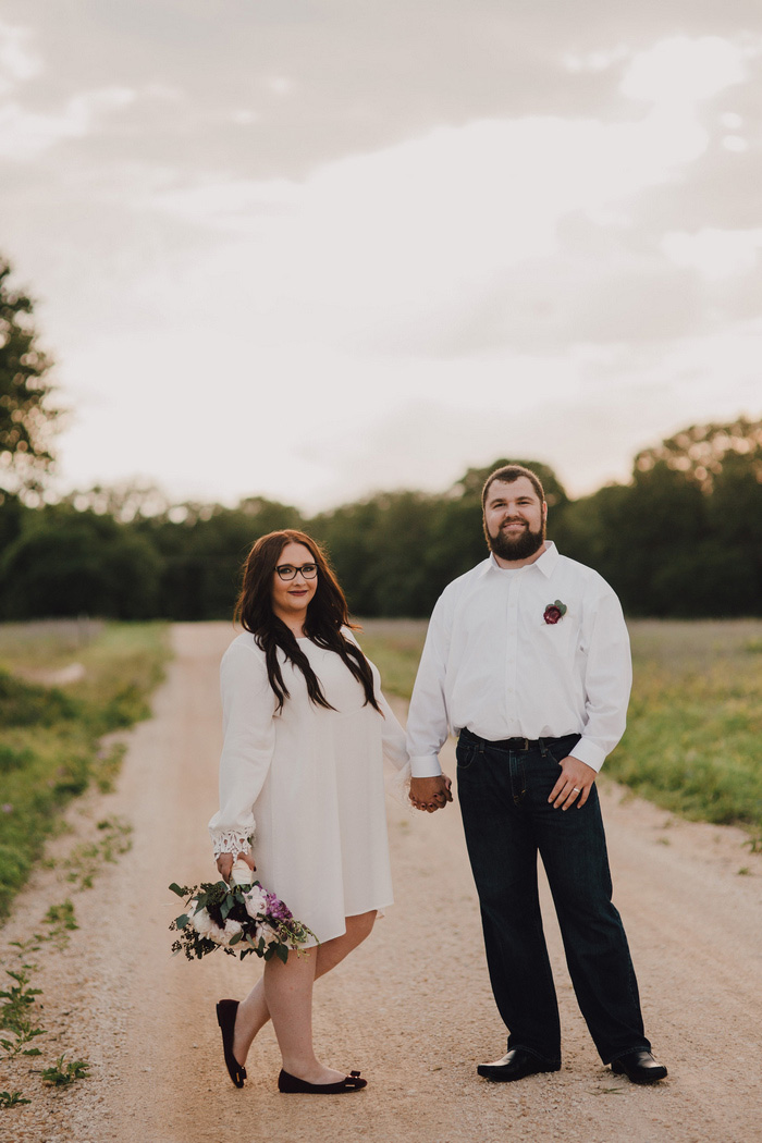 bride and groom portrait on dirt road