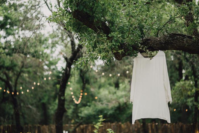 wedding dress hanging in trees
