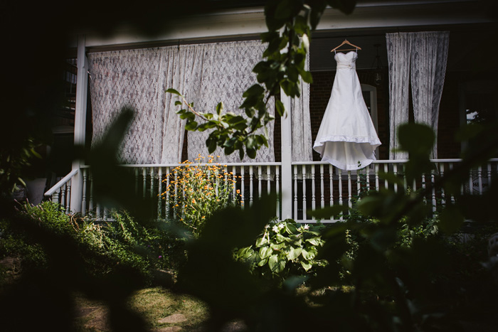 wedding dress hanging on porch