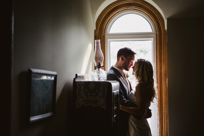 bride and groom portrait by window