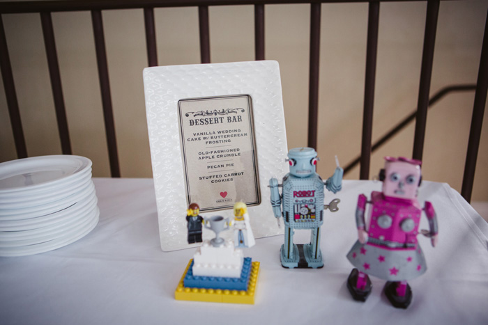 dessert table sign with vintage toys