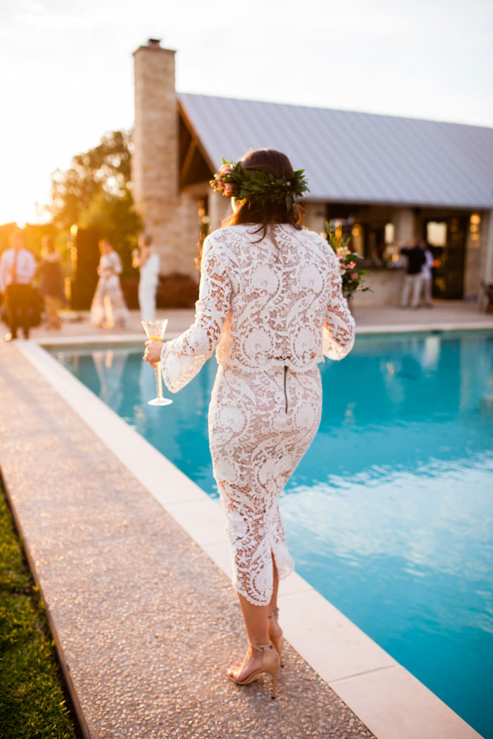 bride walking by pool