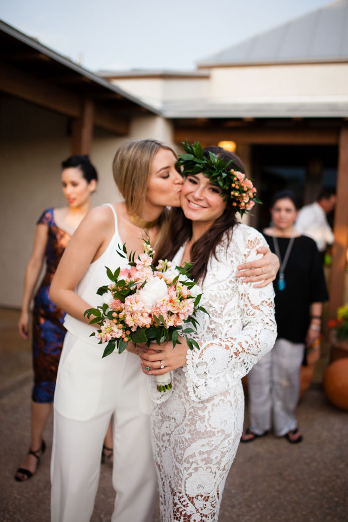 maid of honor kissing bride