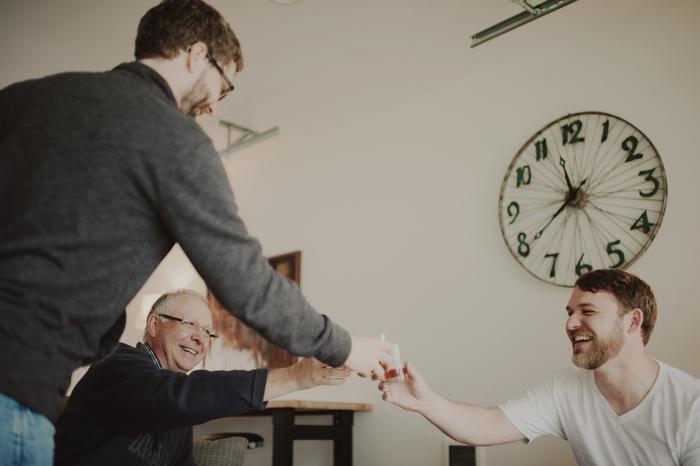 groom having a drink with groomsmen