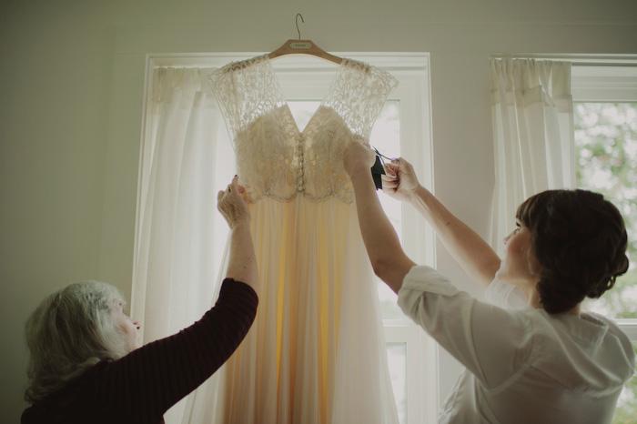 bride steaming wedding dress