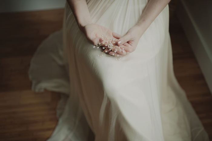 bride holding hairpiece