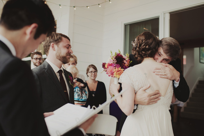 bride hugging father at altar