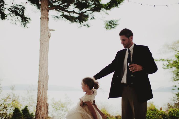 groom twirling flower girl