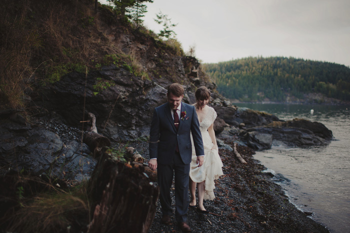 bride and groom walking on rocks