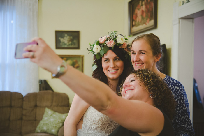 bride taking selfie with friends