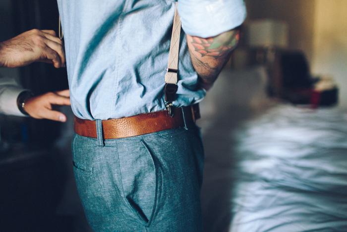 groom tucking in shirt