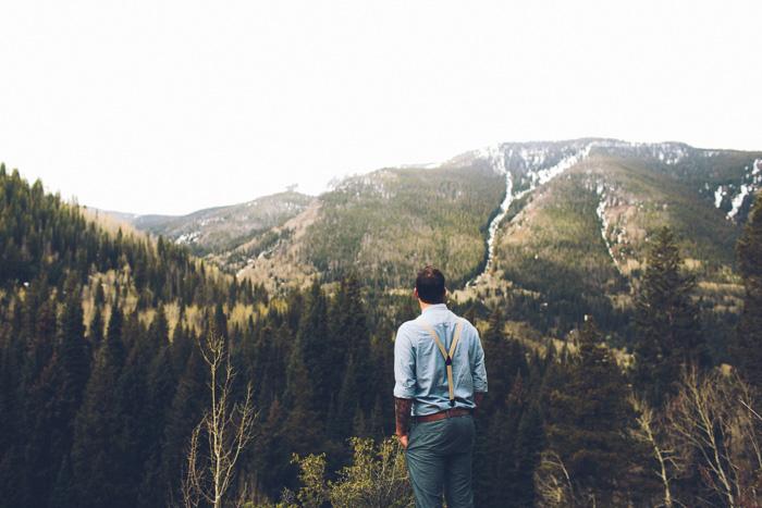 groom overlooking Colorado wilderness
