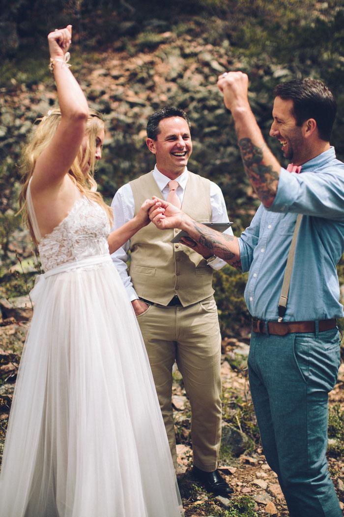 bride and groom celebrating after saying I do