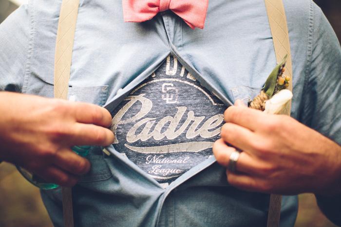 groom revealing Padre shirt under button-up