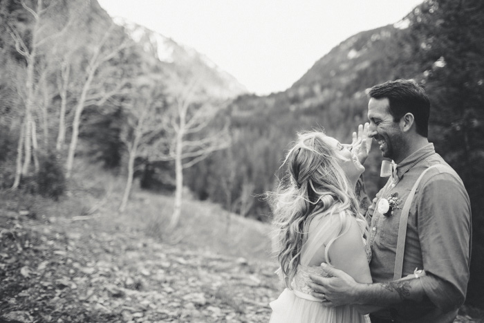 bride and groom dancing on mountainside