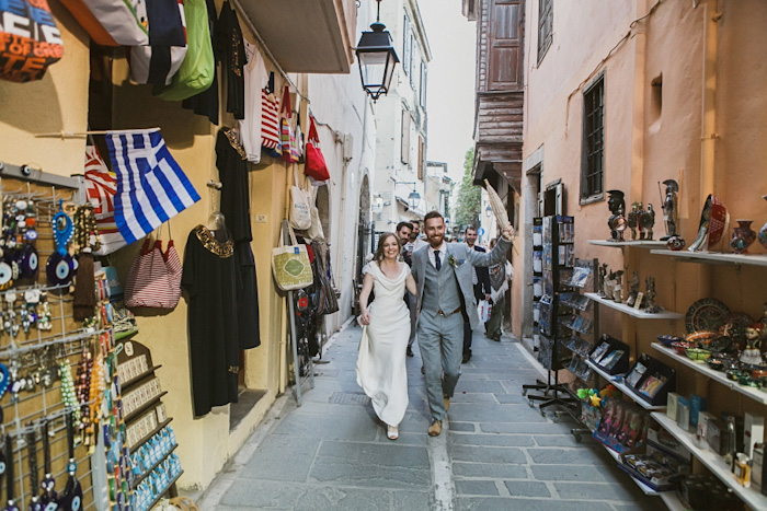 bride and groom walking through Crete streets
