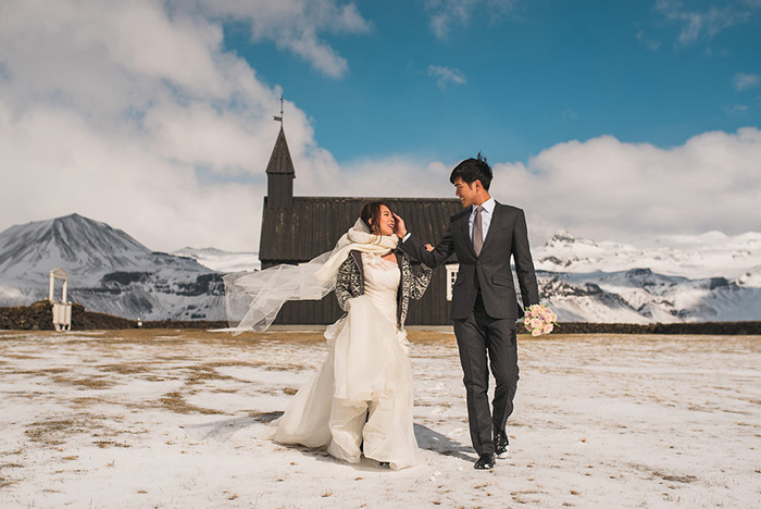 bride and groom leaving iceland chapel