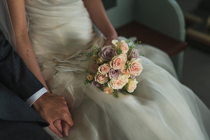 bride with bouquet in lap