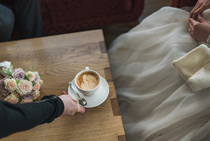 bride and groom with coffee