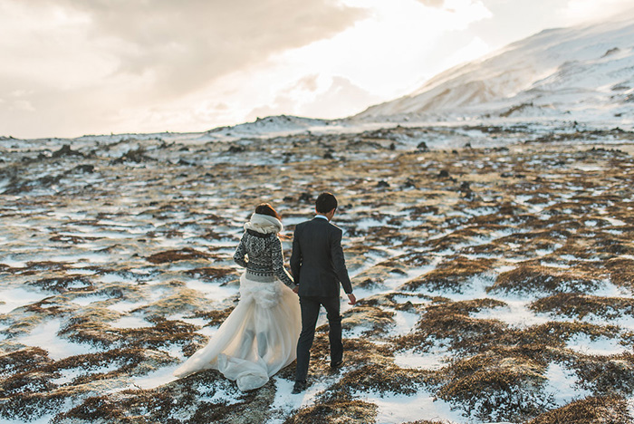 bride and groom walking in Iceland