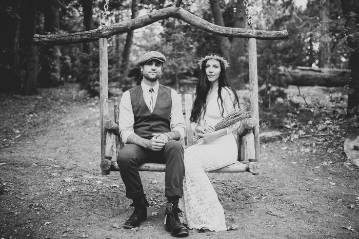 bride and groom sitting on swing