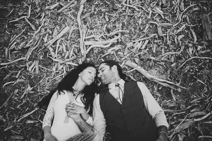 bride and groom lying on the ground