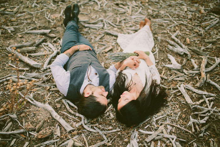bride and groom portrait lying on the ground