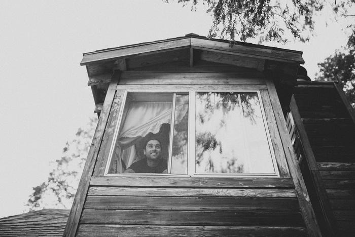 groom looking out cabin window