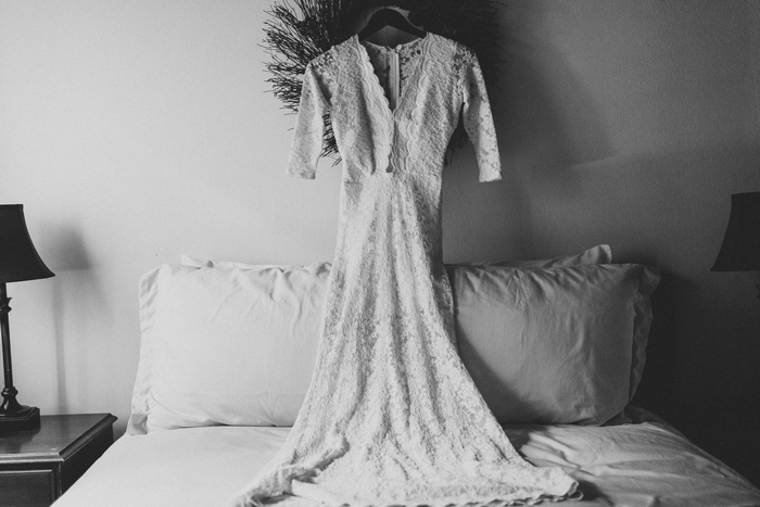 wedding dress hangingover bed