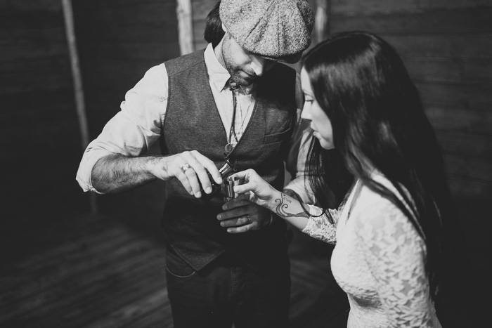 bride and groom taking a shot
