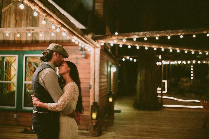 bride and groom dancing on cabin patio