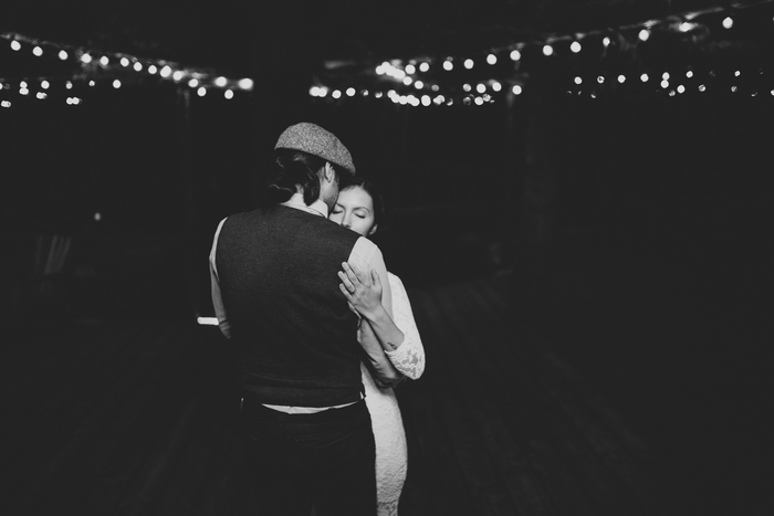 bride and groom dancing on cabin patio