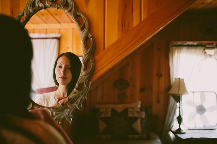 bride's reflection in mirror