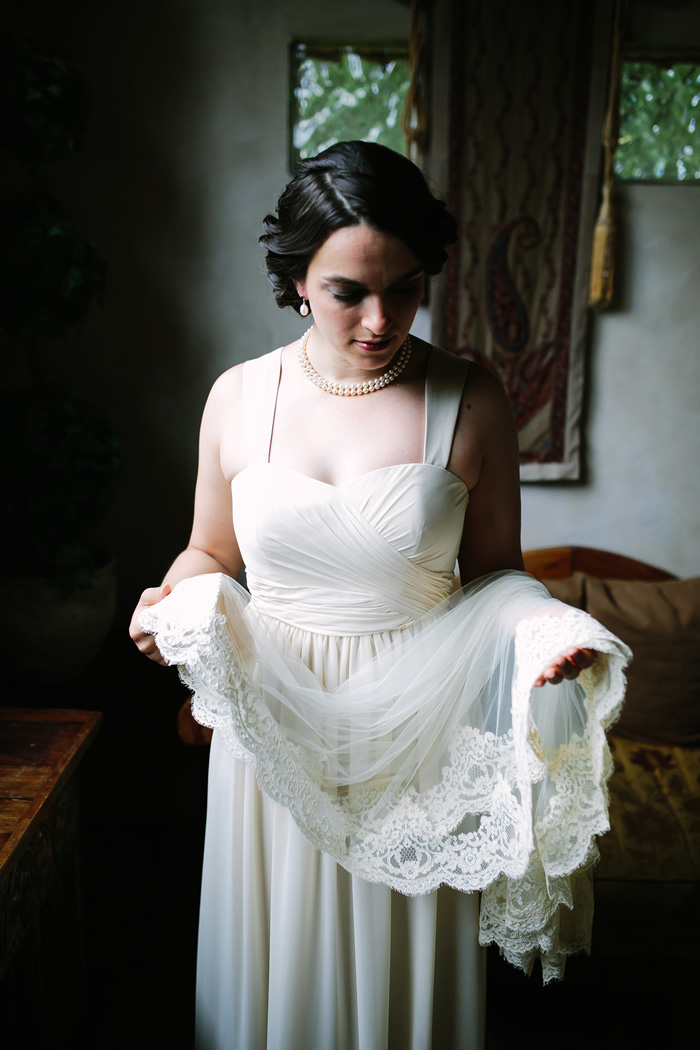 bride holding lace trimmed veil