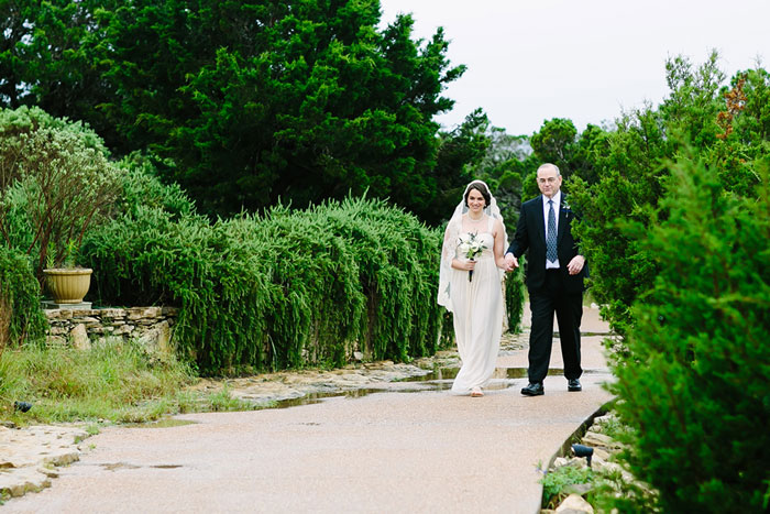 bride walking to chapel with her father