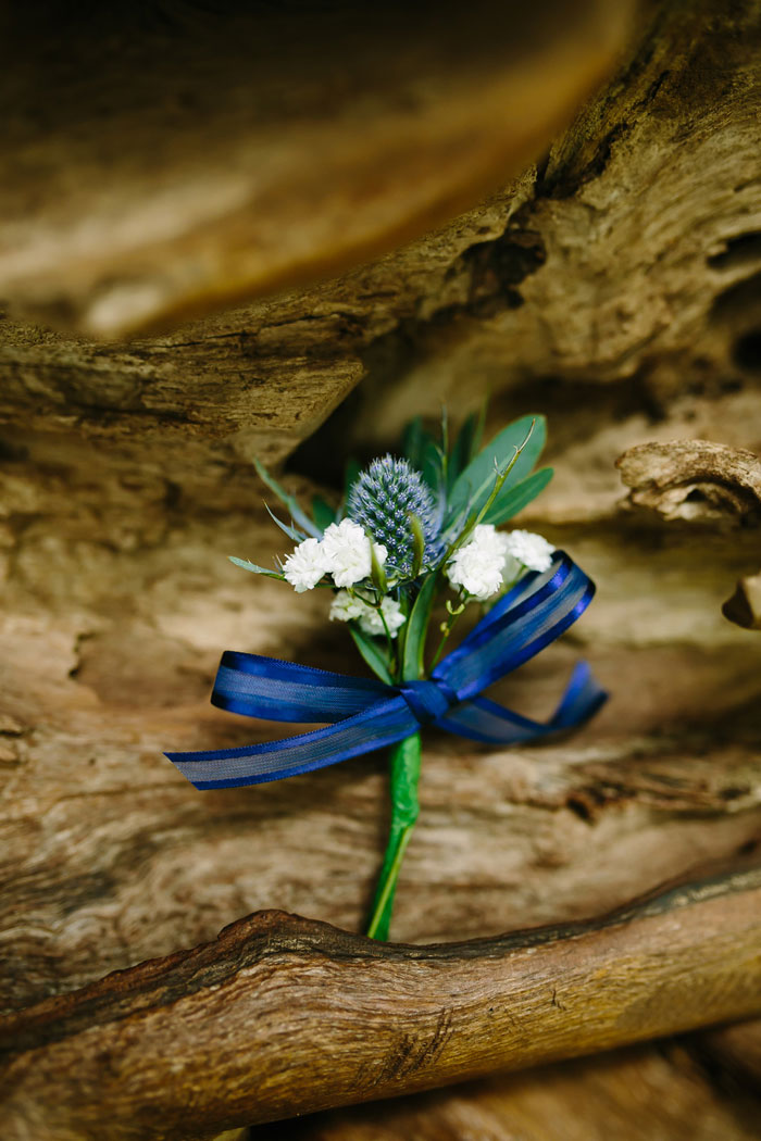 boutonniere on driftwood