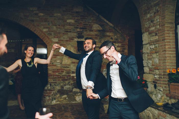 groom dancing with guests