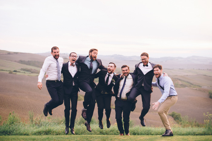 groom jumping with guests