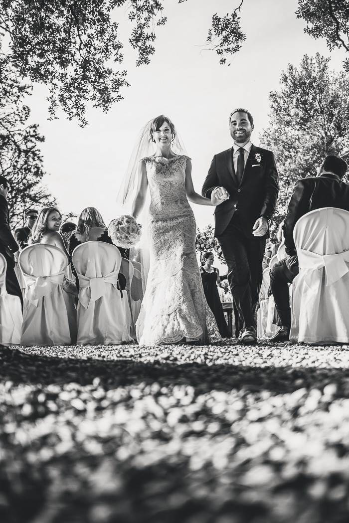 bride and groom walking up aisle