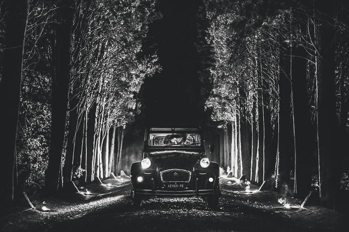 bride and groom in vintage getaway car