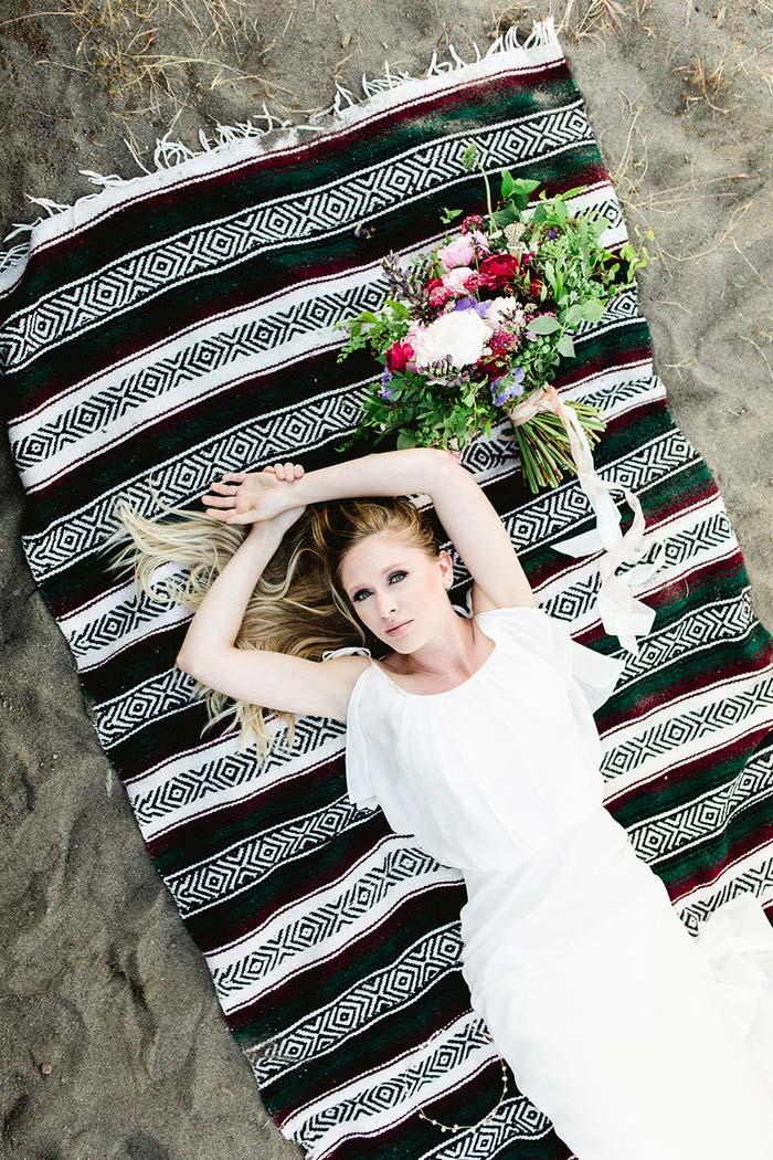 bride lyingonbeach blanket