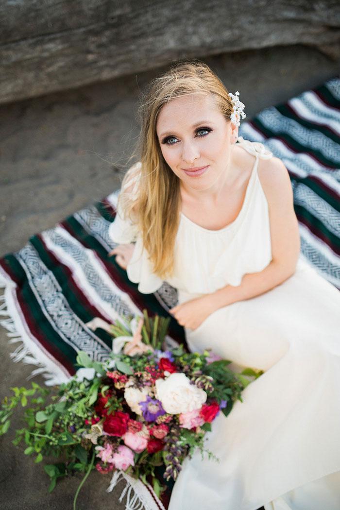 bride on beach blanket
