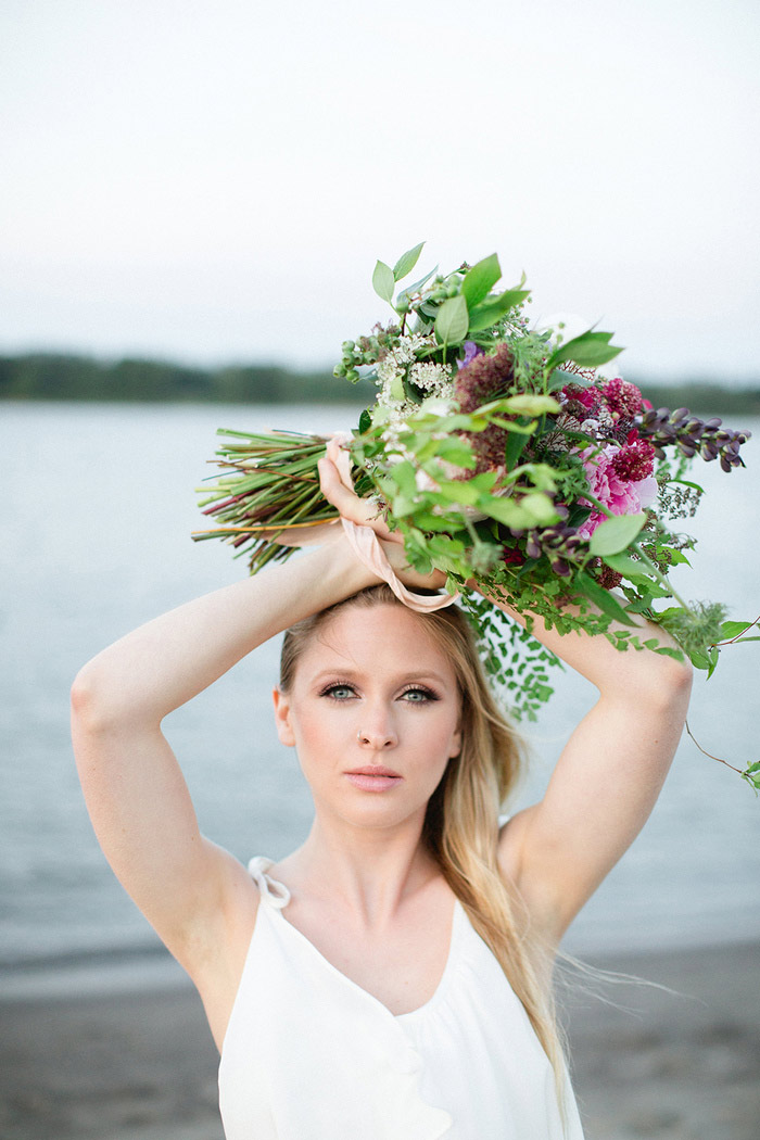 bride holding bouquet over her head