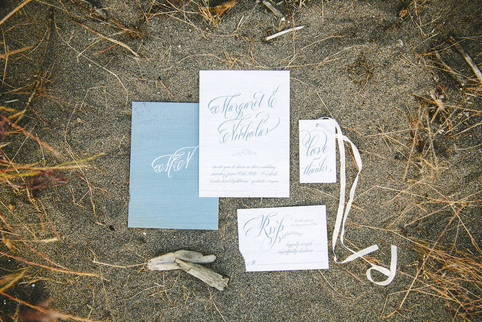 wedding invitation suite in the sand